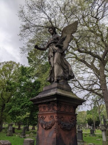 Angel on tombstone at Woodland Cemetery, Cleveland, OH