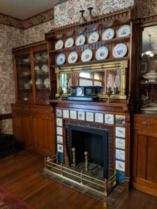 The fireplace in the Garfield home with hand painted tiles.